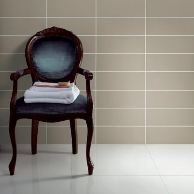 Johnson Vivid Clay Gloss Brick Ceramic Wall Tile with chair