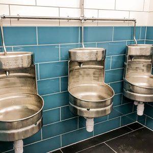 Johnson Teal Gloss Brick Ceramic Wall Tile In The Medicine Tap Bathroom